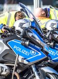Close-up of German police motor bikes with anonymous police men. In the background Royalty Free Stock Photo