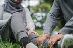 Senior`s hand giving massage on leg royalty free stock photos