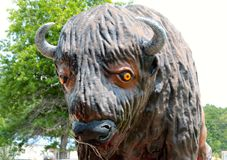 Close-Up of a Giant Statue Of A Bison. Bison are large, even-toed ungulates in the genus Bison within the subfamily Bovine. There are two extant and four extinct Stock Photography