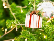 Close up gift box on Christmas tree Stock Photos