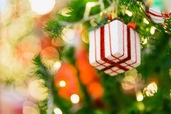 Close up gift box on Christmas tree Royalty Free Stock Photo