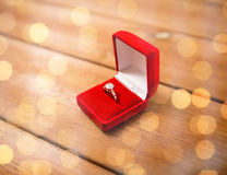 Close up of gift box with diamond engagement ring. Proposal, engagement, valentines day and holidays concept - close up of red gift box with diamond engagement stock images