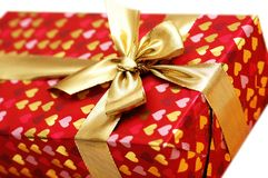 Close up of gift box with gold. En  ribbon Royalty Free Stock Image