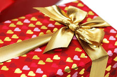 Close up of gift box with golden  ribbon. Close up of gift box  with golden  ribbon Royalty Free Stock Image