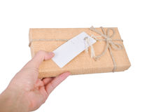 Close up of Gift box in hand holding isolated on white. Close up of Gift box on hand holding isolated on white background Royalty Free Stock Photo