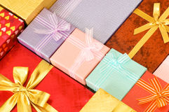 Close up of gift boxes with golden ribbons Stock Image