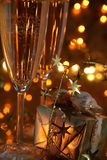 Close-up of gift and champagne in glasses. Stock Photography