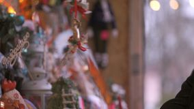 Close-up of a gift shop at christmas. The buyer chooses a gift, to touch the crafts stock footage