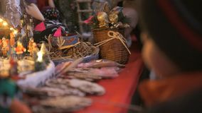 Close-up of a gift shop at Christmas. The buyer chooses a gift, to touch the crafts stock video footage