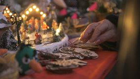 Close-up of a gift shop at Christmas. The buyer chooses a gift, to touch the crafts stock video