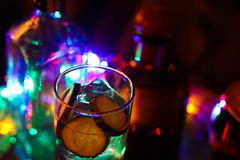 Close up of Gin Tonic with cucumber and ice cubes royalty free stock photography