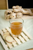 Close up of Ginger tea in glass. On bamboo tray Stock Photography