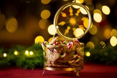 Close-up gingerbread and candy cane jar. royalty free stock image