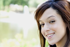 Close up of girl. A close up portrait of the face of a pretty brunette girl with a sweet smile Royalty Free Stock Photo