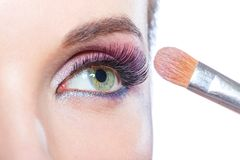 Close up of girl applying bright make-up Royalty Free Stock Images