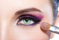 Close up of girl applying brilliant make-up stock image