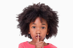 Close up of a girl asking silence Royalty Free Stock Photos