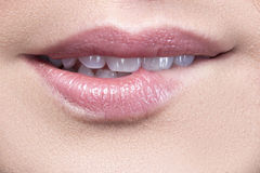 Close up of girl biting coral lips Royalty Free Stock Images