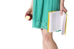 Close-up of girl with book and apple. Royalty Free Stock Photography