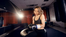 The close-up of the girl boxer putting on boxer gloves. 4K. stock footage