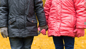 Close up of girl and boy holding hands outdoors Stock Images