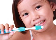 Close up of a girl brushing her teeth Stock Image