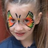 Portrait of girl with painted face. Close up of girl with butterfly painted on face stock photos