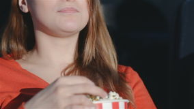 Close up girl chewing popcorn stock video footage