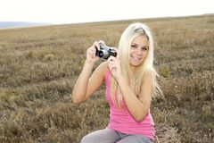 Close up of a girl clicking camera Royalty Free Stock Photos