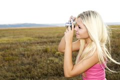Close up of a girl clicking camera Stock Image