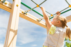 Close up of girl climbing on children playground Stock Image