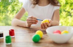 Close up of girl coloring easter eggs royalty free stock photos