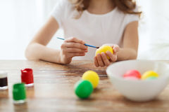 Close up of girl coloring eggs for easter Royalty Free Stock Photography
