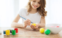 Close up of girl coloring eggs for easter Stock Photos