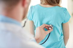 Close up of girl and doctor on medical exam Royalty Free Stock Image