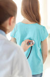 Close up of girl and doctor on medical exam Royalty Free Stock Photos