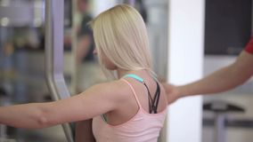 Close up of girl doing butterfly exercises stock video footage
