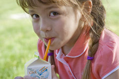 Close up of girl drinking juice from box Stock Photo