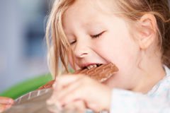 Close Up Of Girl Eating Bar Of Chocolate Royalty Free Stock Photography