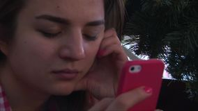 Close up of girl face using smartphone. In bar stock video footage