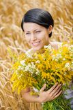 Close up of girl with flowers in the field Stock Photo