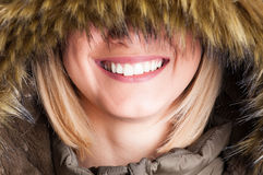 Close-up of girl with fur hood with eyes covered Royalty Free Stock Images