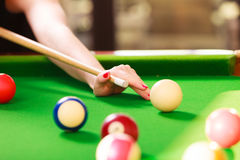 Close up on girl hand playing billiard. Stock Images
