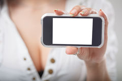 Close-up of a girl hand showing a horizontal blank smartphone sc Royalty Free Stock Photography