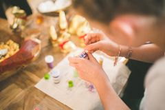 Close up of girl hands coloring eggs for easter II Stock Photography