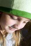 Close up of girl with hat. Close up shot of a young girl outside and deep in thought stock images