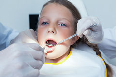 Close up of girl having her teeth examined Royalty Free Stock Image