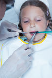 Close up of girl having her teeth examined Stock Photography