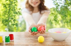Close up of girl holding colored easter eggs royalty free stock image