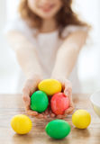 Close up of girl holding colored eggs Stock Photo